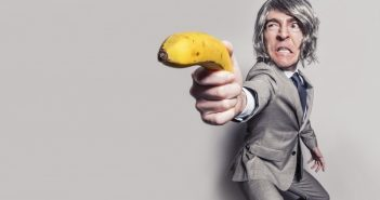 businessman-aiming-with-banana