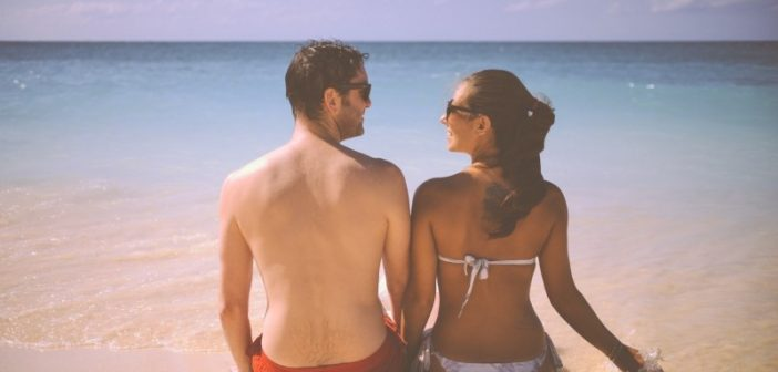 young-couple-relaxing-on-beach-1